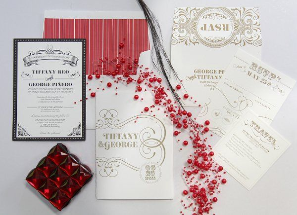 A gorgeous custom invitation suite combines elements from vintage posters as well as French and...