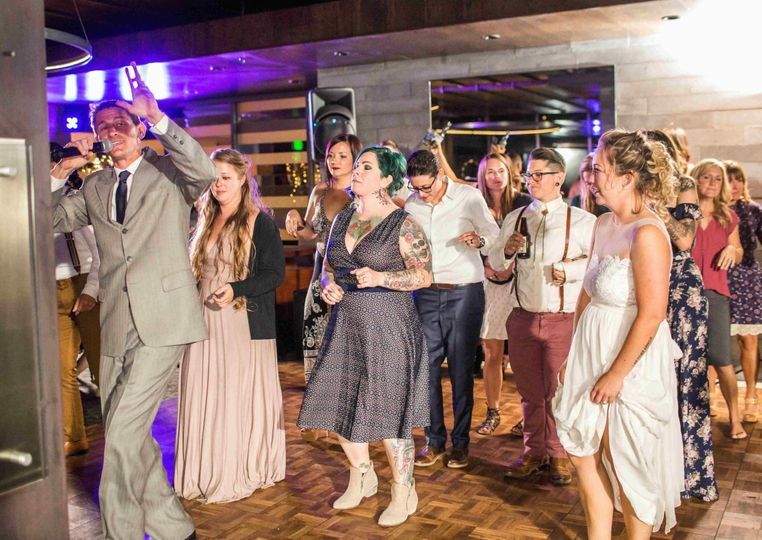 DJ Aaron leading group dance