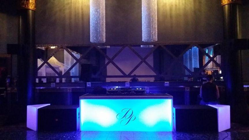 DJ booth with custom fascia skirting and uplighting