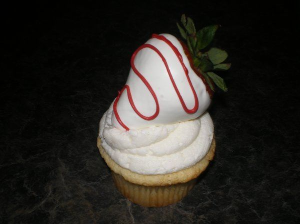 white chocolate gourmet cupcake with white chocolate covered strawberry