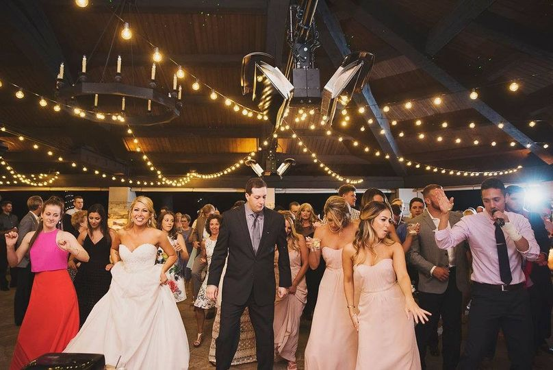The couple dancing with the guests