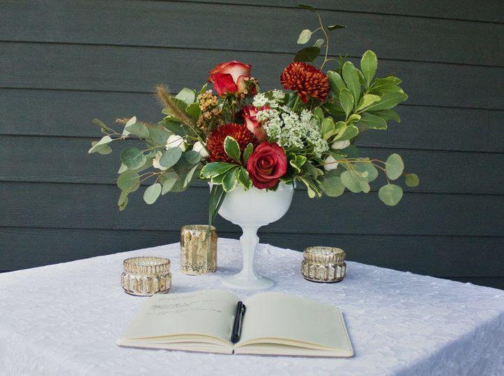 Guest book table floral arrangement