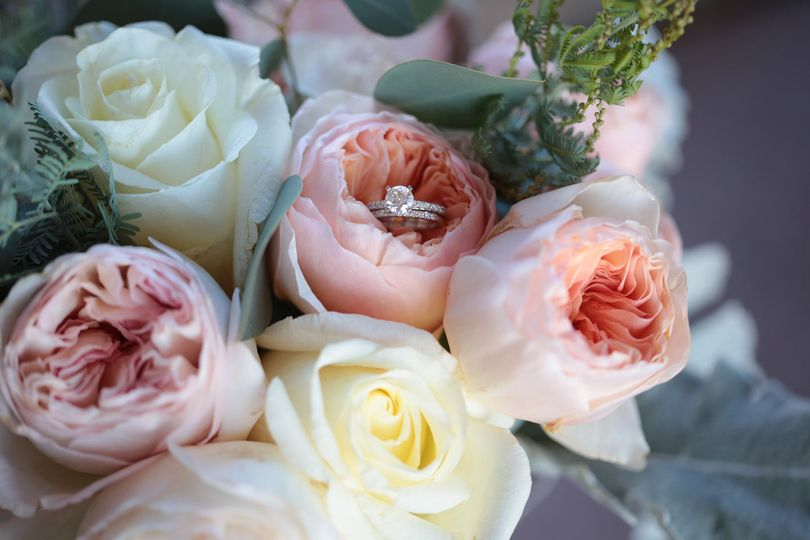 Close up of bridal bouquet With Wedding Bands: Teri Roy Photography