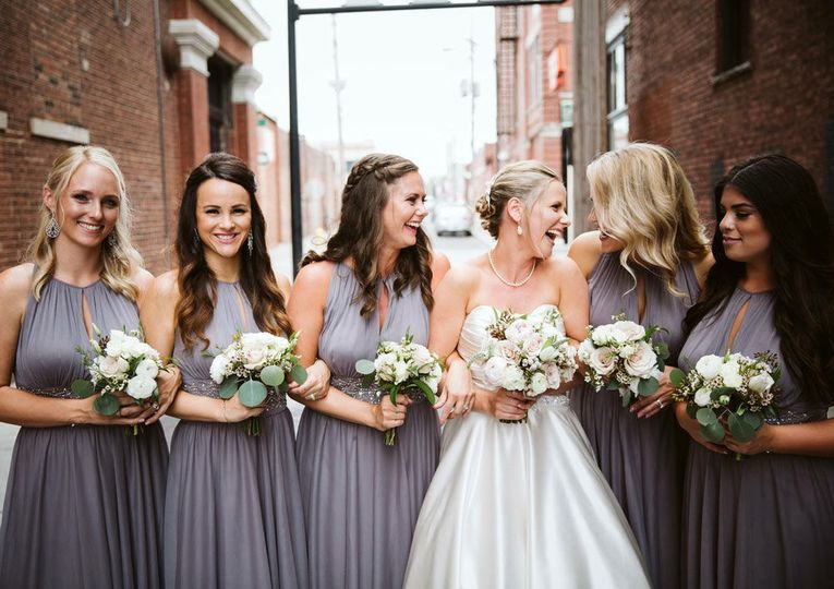 Bridal party bouquets in neutral and blush tones: Adam & Dawn Photography