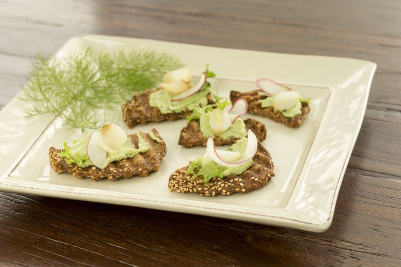 fava bean puree on rustic toasts with caramelized shallots