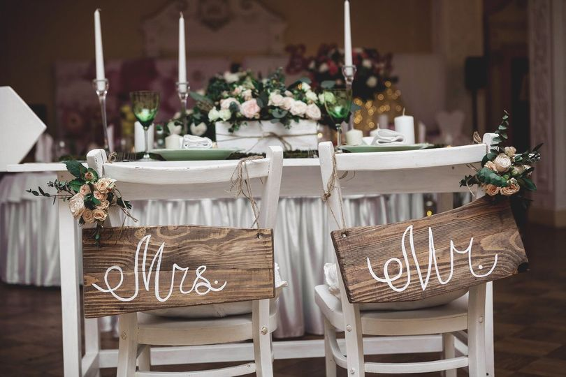 Newlyweds' reception table and seats