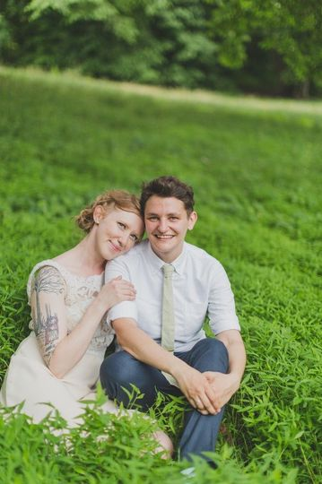 Couple sitting on the grass | Shannon Collins Photography