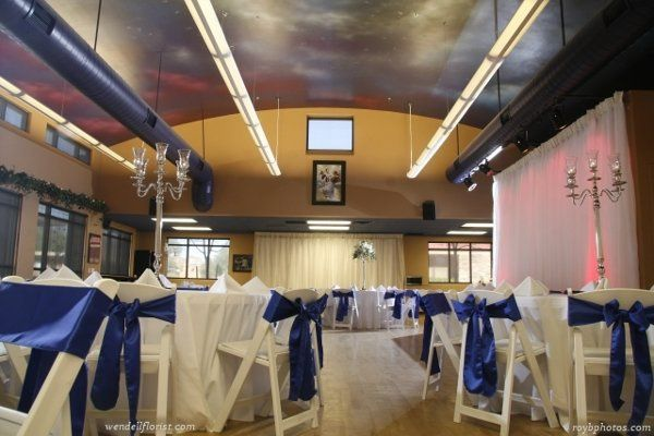 Wedding with royal blue chair bows and custom accent lighting - magenta - for Stars Ballroom