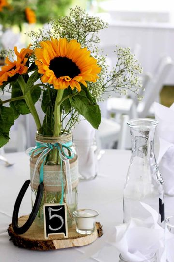 The bride made the centerpieces, and we worked with the theme adding floral arrangements to our...