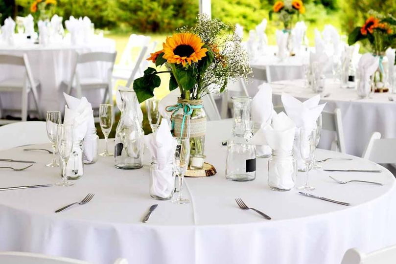 Table settings by Pierrot Catering. Each guest received a handled mason jar for iced tea and...