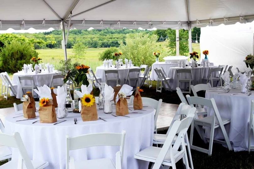 This wedding was on the family's farm. Pierrot Catering arranged all rentals and linens