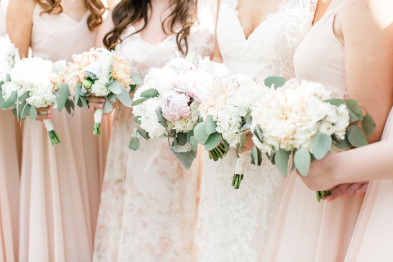 Peach dresses and white bouquets