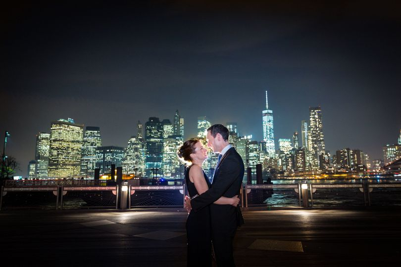 Bride and groom overlooking the city lights