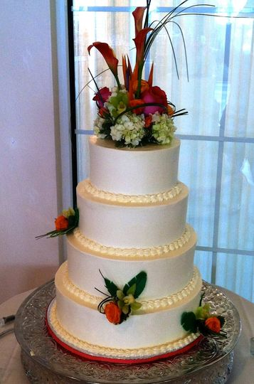 This four tier 14/12/10/8 was comprised of a variety of flavors like chocolate cake with espresso...