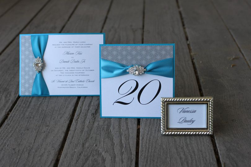 Teal and silver collection, invitation with brooch, table number and framed place card