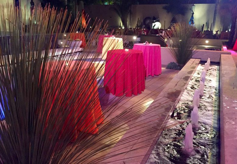 Outdoor casual reception with lots of bright vibrant colors to communicate an energetic vibe.