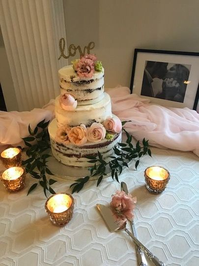 "Romantic ""naked cake"" adorned with flowers that matched the bride's bouquet"
