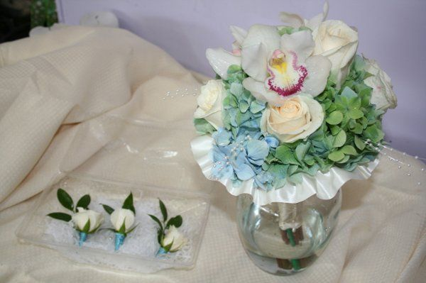 Hand tied Bridal bouquet with blue hydrangea, White Cymbidium orchids and pearls