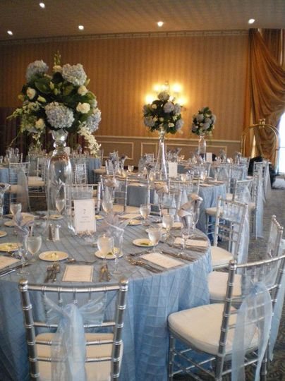 We can take your color theme throughout the entire wedding decor as seen in this blue and white...