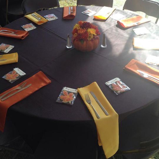 Table setting with orange and yellow decor
