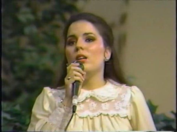 Lisa sings in a service in 1986