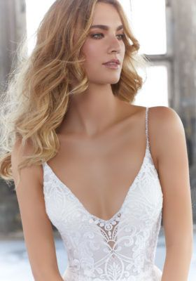 Sleeveless wedding gown and deep neck line