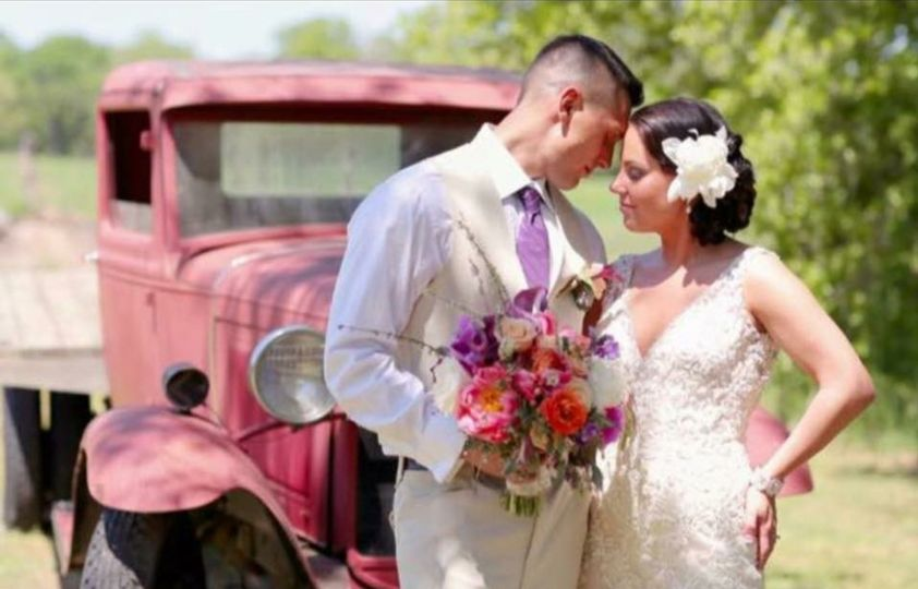 Newlyweds by the truck