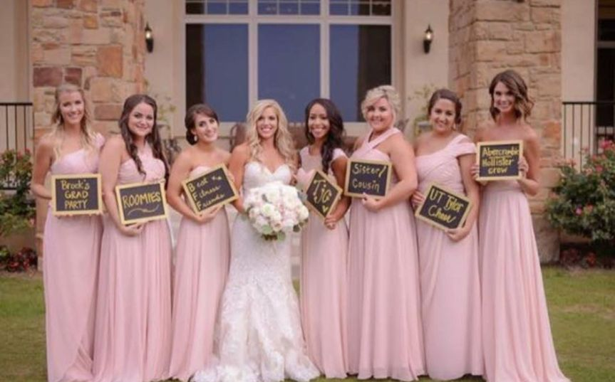 Bride and her bridesmaids with signs