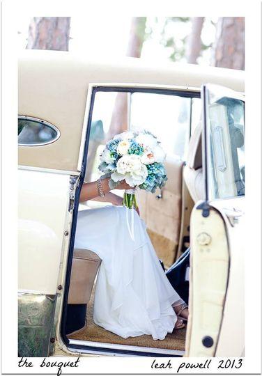 blue white bride bouquet with rolls royce leah