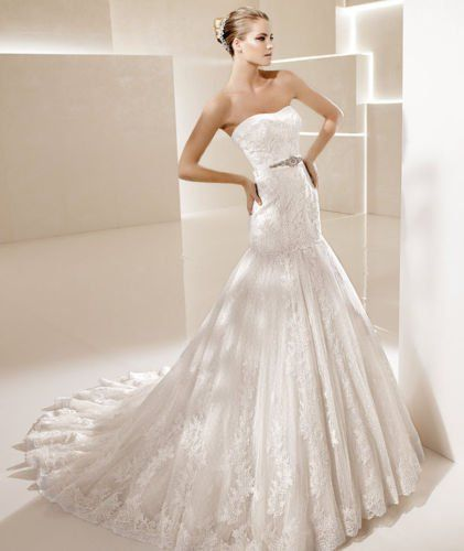 Strapless lace gown with modified sweetheart neckline and flowing trumpet skirt from Bellisima's...