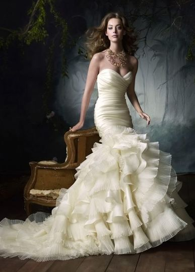 Organza gown with sweetheart neckline, dropped waist, and multi-layer ruffled skirt.  Similar styles...