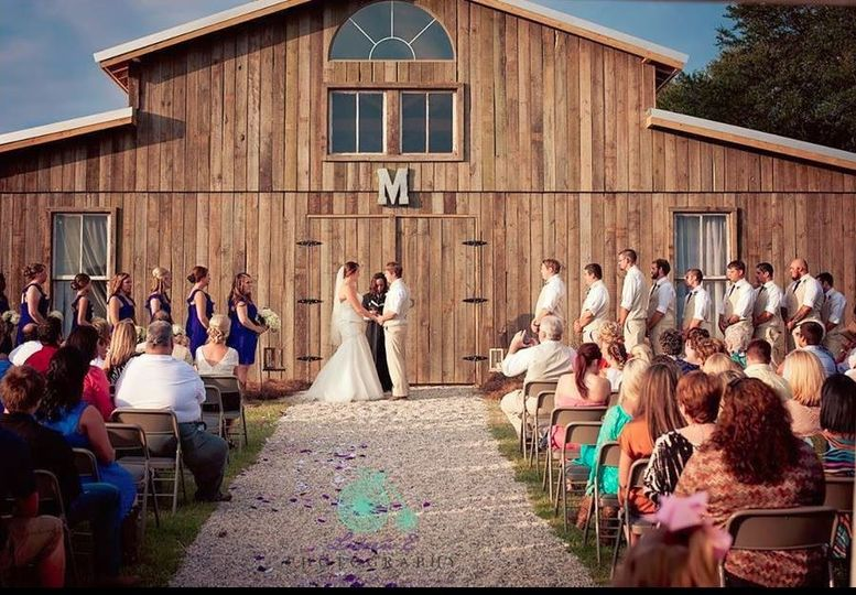 Wedding ceremony in front of the barn