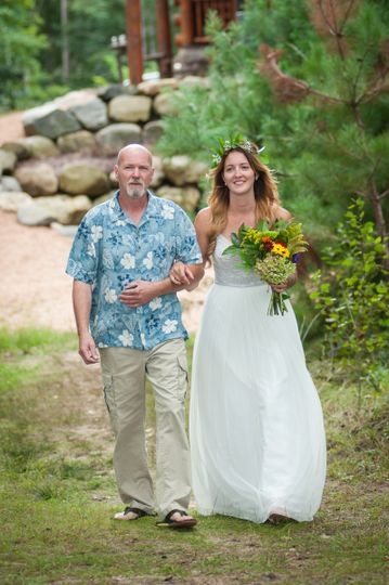 Bride and her father making their way from the lodge to the wedding on the beach.