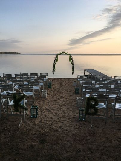 Set-up for beautiful wedding on the beach at sunset