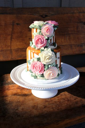 Semi-naked chocolate cake, buttercream flowers and salted caramel drip