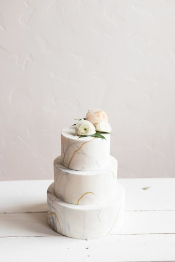 Marbled fondant with gold accents and fresh flowers