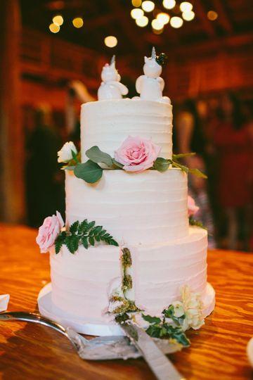 Pistachio cake with fresh raspberries and vanilla Italian buttercream