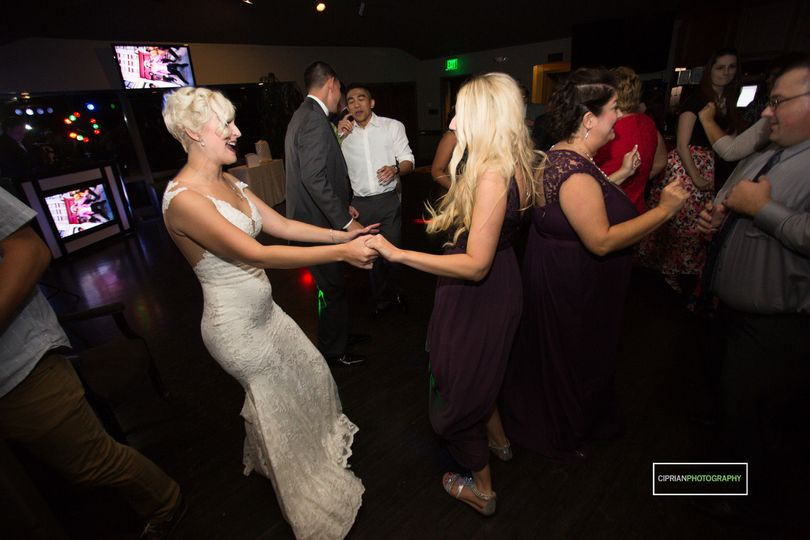Bride dancing with her guest