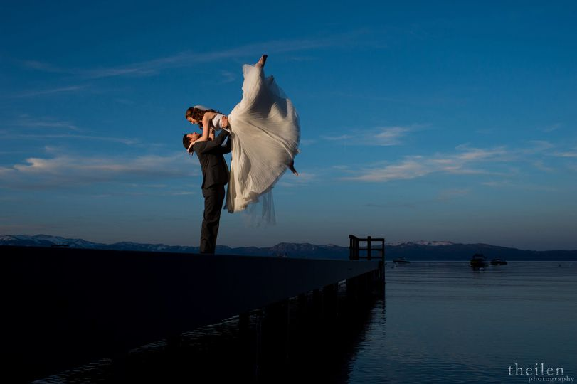 Groom lifts his bride