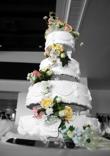 Tell your cake decorator you want a cake top and silk flowers from our store...it's the perfect...