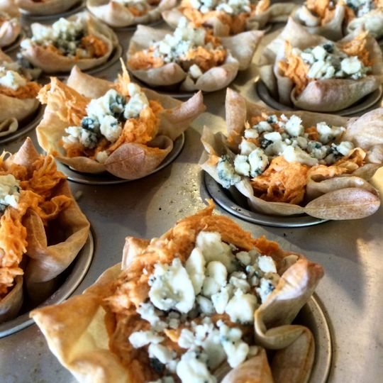 Buffalo chicken wonton cups with blue cheese