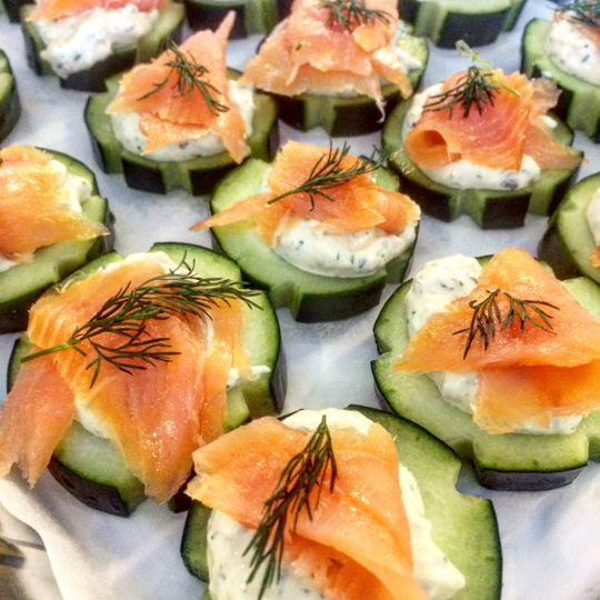 Smoked salmon and herbed cream cheese canapés on cucumber
