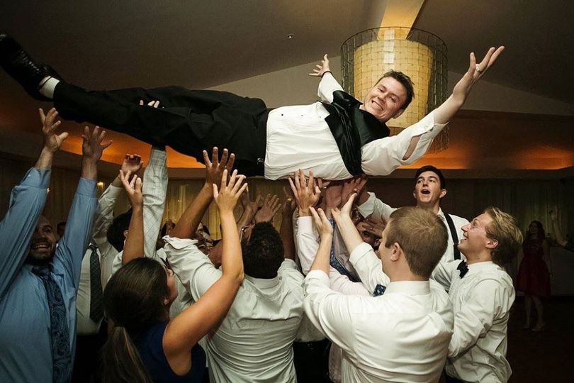 Groom crowd surfing