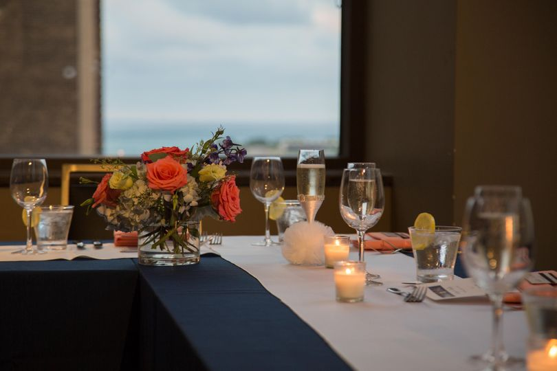 Table setup with bouquet and candle centerpiece