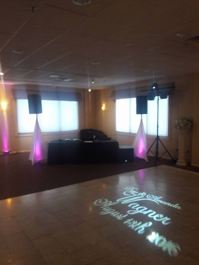 DJ set-up at receptions with monogram lighting