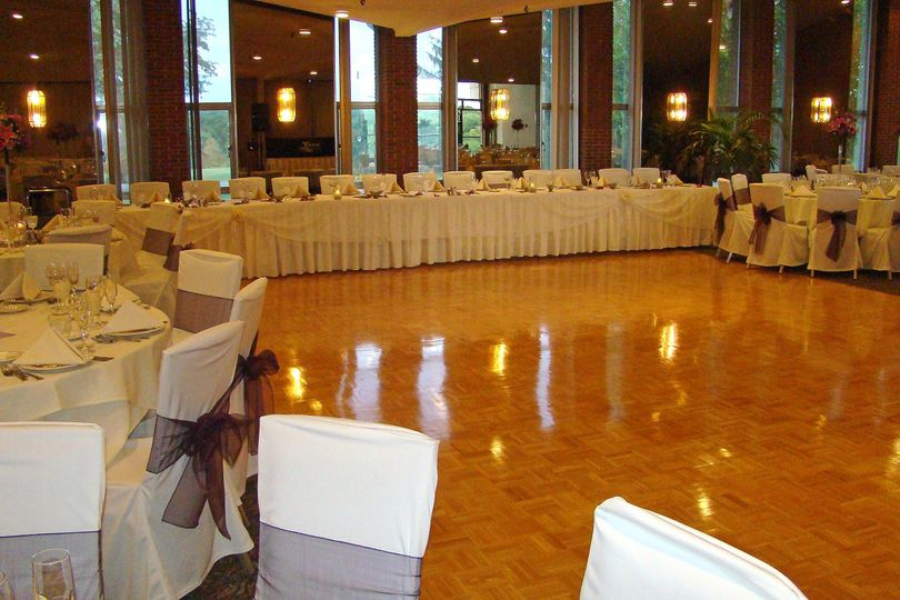 Spacious dance floor and natural lighting in the ballroom