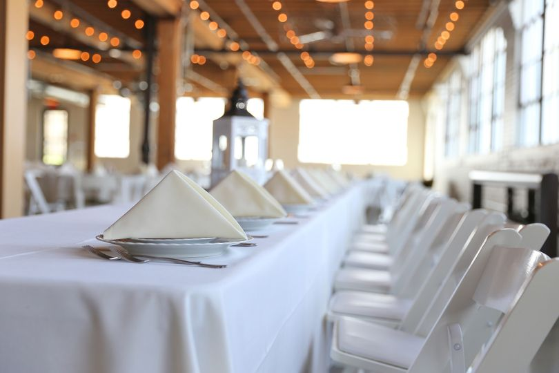 WHITE LINENS, IVORY NAPKINS, WHITE GARDEN CHAIRS