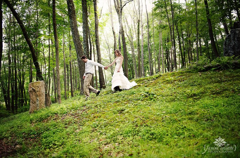 bride sandi and groom walking inthe woods at kirkr