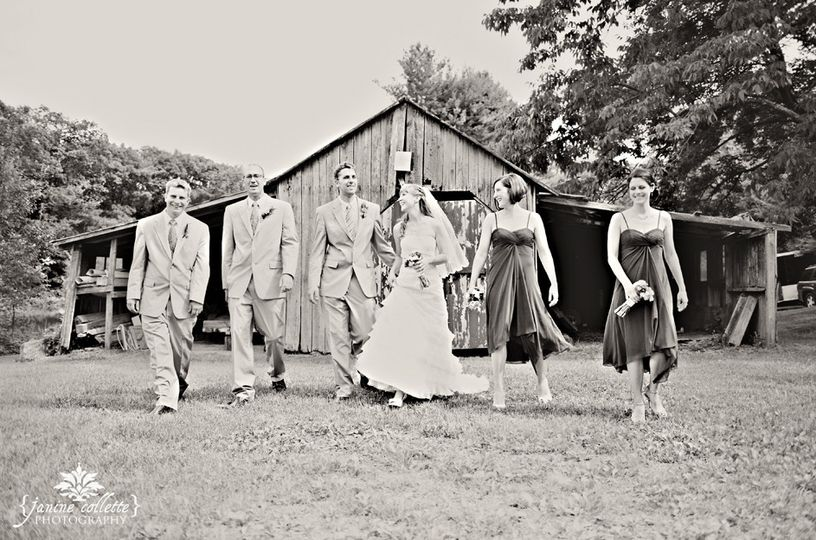 bride sandi with wedding party at barn in bw