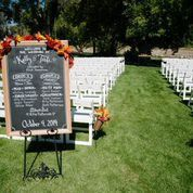 hans ceremony chairs with chalk board